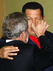Brazil's President Lula da Silva interacts with Venezuela's President Chavez as they chat at the 5th Summit of the Americas in Port of Spain