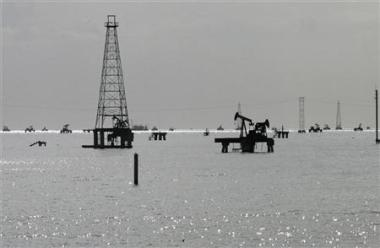 Oil rigs are seen on Lake Maracaibo from the shore in Cabimas